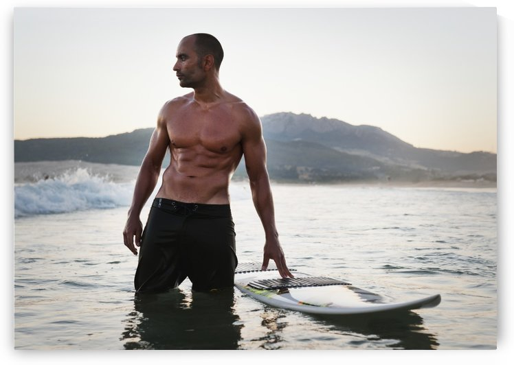 A Man Standing In The Water With His Surfboard Off Valdevaqueros Beach; Tarifa, Cadiz, Andalusia, Spain by PacificStock