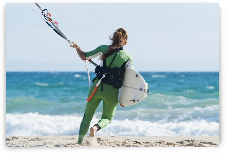 A Woman With Her Kitesurfing Board Walking Into The Water; Tarifa, Cadiz, Andalusia, Spain by PacificStock