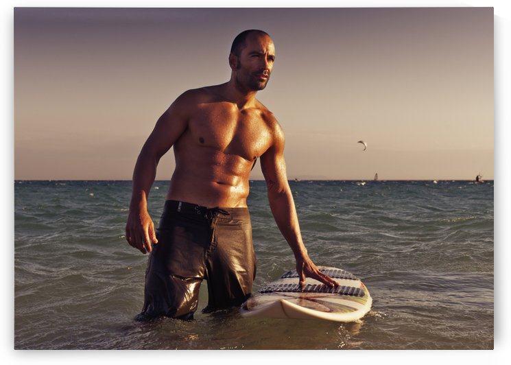 A Man With His Surfboard In The Water At Sunset; Tarifa, Cadiz, Andalusia, Spain by PacificStock