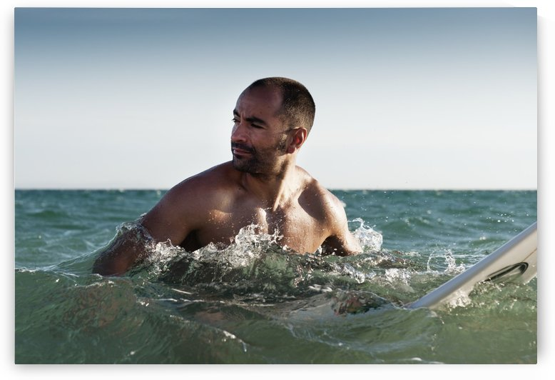 A Man With His Surfboard In The Water; Tarifa, Cadiz, Andalusia, Spain by PacificStock