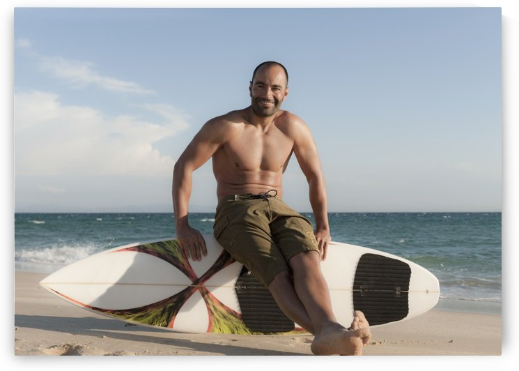 A Man Sits On His Surfboard On The Beach; Tarifa, Cadiz, Andalusia, Spain by PacificStock