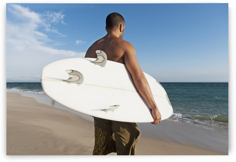 A Man Standing On The Beach Holding His Surfboard; Tarifa, Cadiz, Andalusia, Spain by PacificStock