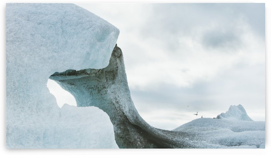 A Unique Ice Formation Forming An Arch; Iceland by PacificStock
