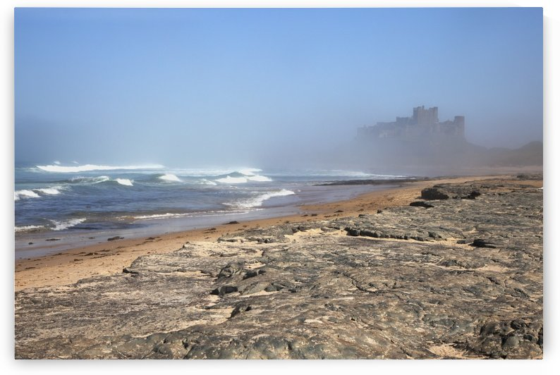 Bamburgh Castle In The Fog; Bamburgh, Northumberland, England by PacificStock
