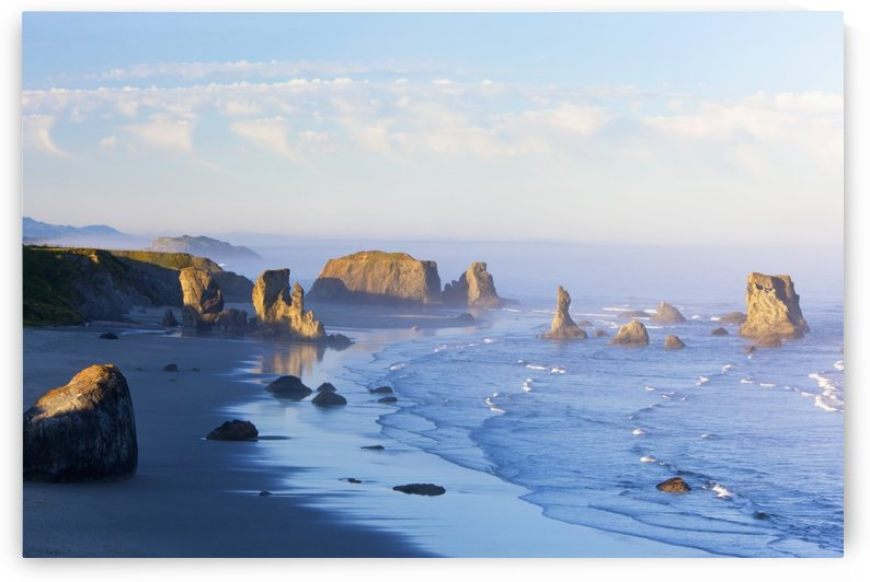 Morning Light Adds Beauty To Fog Covered Rock Formations At Bandon State Park; Bandon, Oregon, United States of America by PacificStock