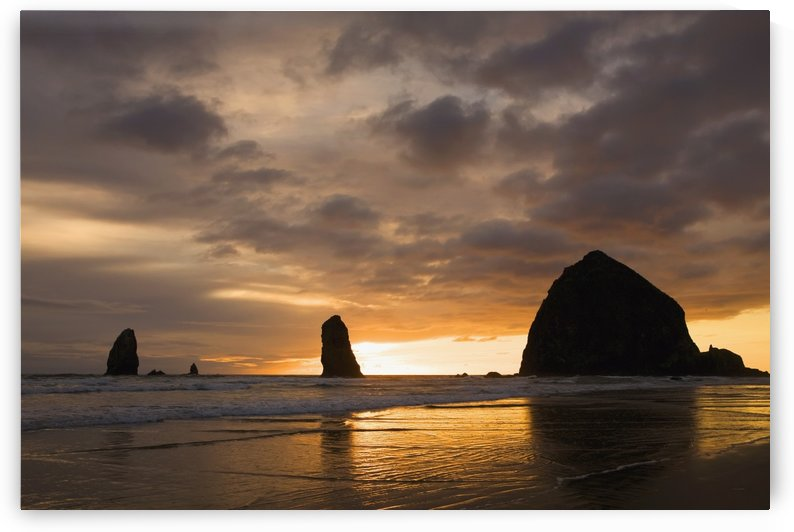 Silhouette Of Rock Formations And Haystack Rock At Sunset; Cannon Beach, Oregon, United States of America by PacificStock