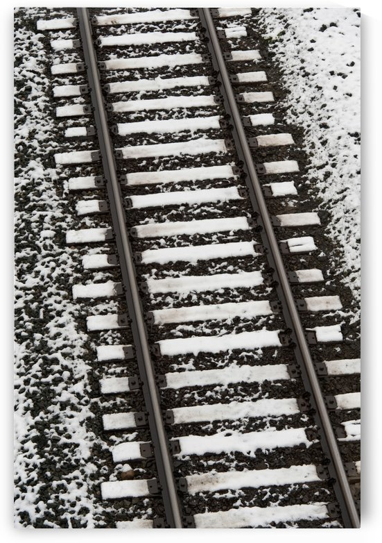Train Tracks Lightly Covered With Snow; Alberta, Canada by PacificStock