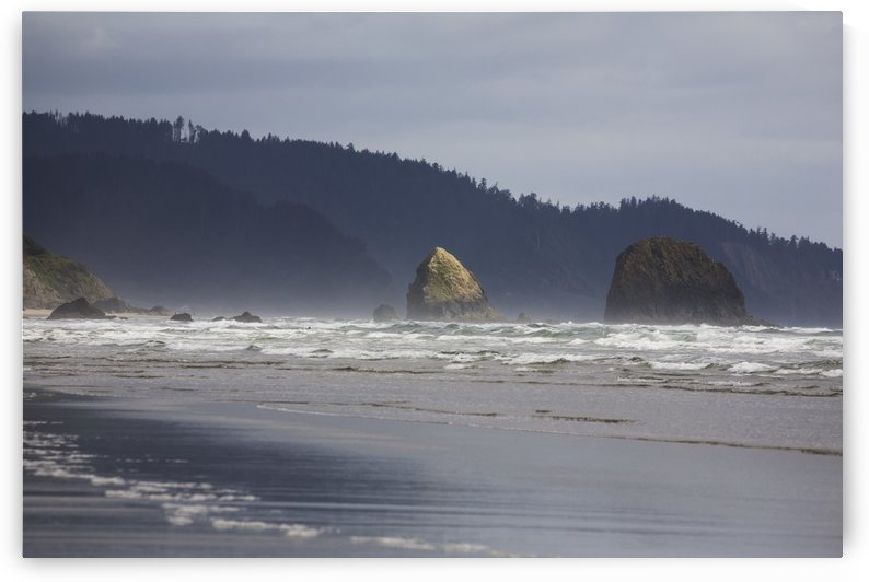 Rock Formations In The Ocean With Waves On The Beach; Cannon Beach, Oregon, United States of America by PacificStock