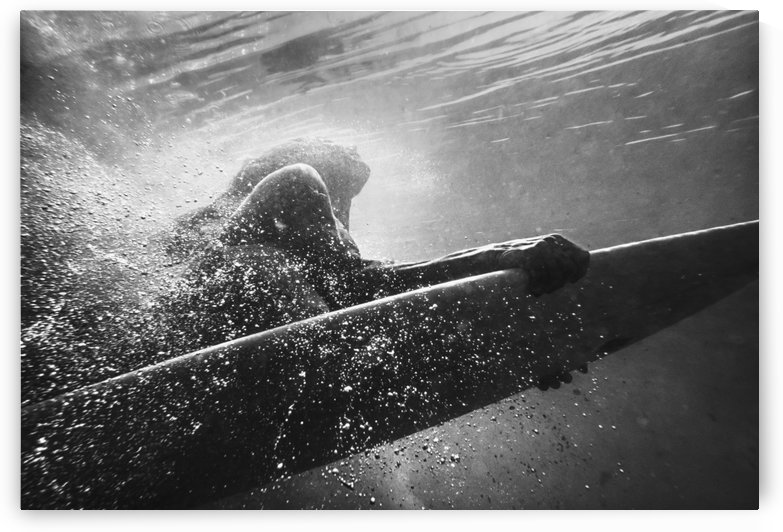 A Woman On A Surfboard Under The Water; Tarifa, Cadiz, Andalusia, Spain by PacificStock