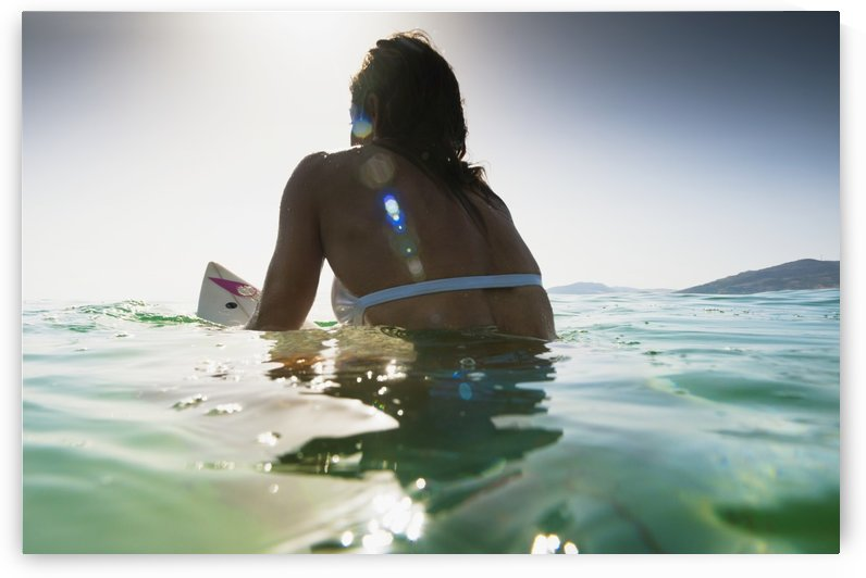 A Woman Sitting On A Surfboard In The Water; Tarifa, Cadiz, Andalusia, Spain by PacificStock