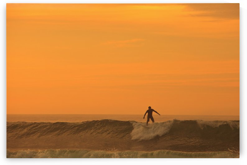 A Surfer On A Wave At Dusk; Baja California Sur Mexico by PacificStock