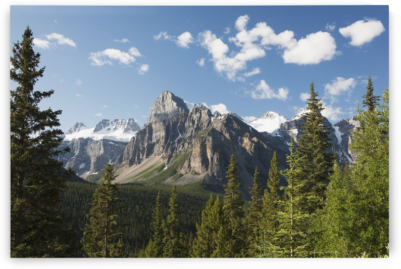 Mountain Vista With Cliff Face And Blue Sky And Clouds; Alberta, Canada by PacificStock