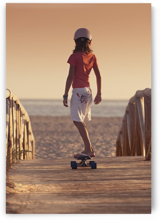A Young Person Skateboarding With Bare Feet Over A Wooden Boardwalk Towards The Beach; Tarifa, Cadiz, Andalusia, Spain by PacificStock