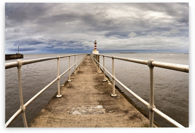 Lighthouse At The End Of A Pier; Amble, Northumberland, England by PacificStock