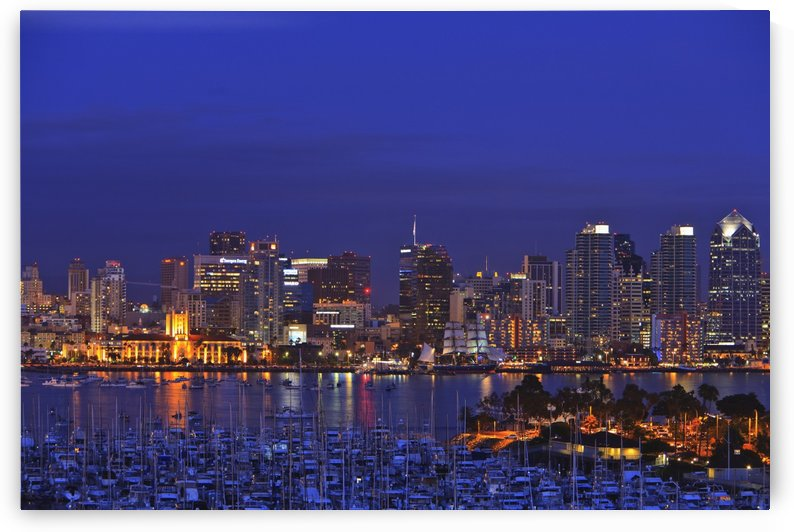 Aerial View Of San Diego Skyline With Harbor Island Boats In The Foreground; San Diego, California, United States of America by PacificStock