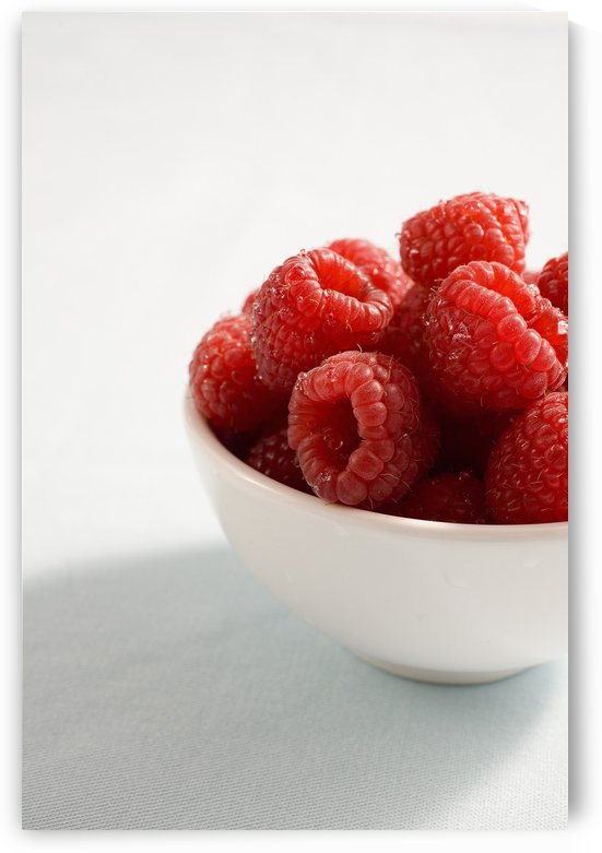Bowl Of Raspberries by PacificStock