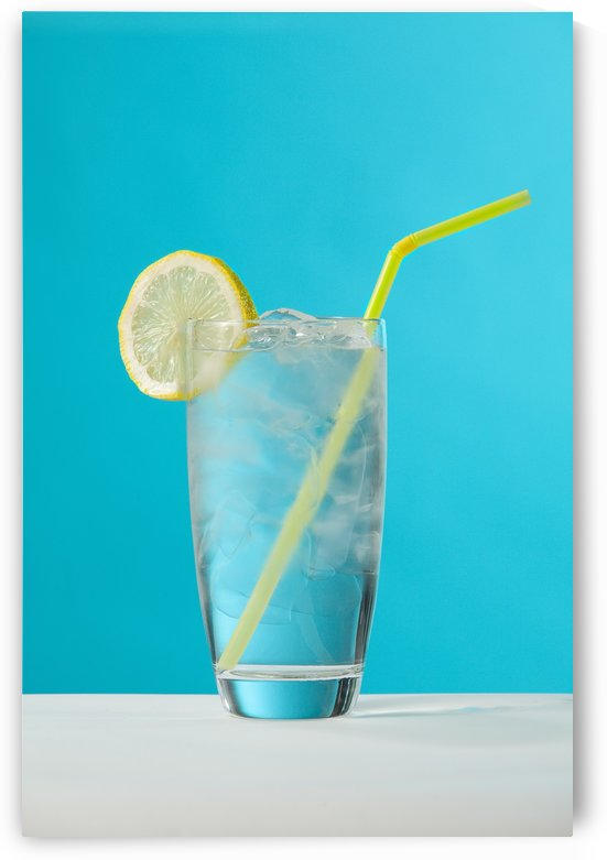 Clear Glass Of Water With Lemon And Drinking Straw by PacificStock