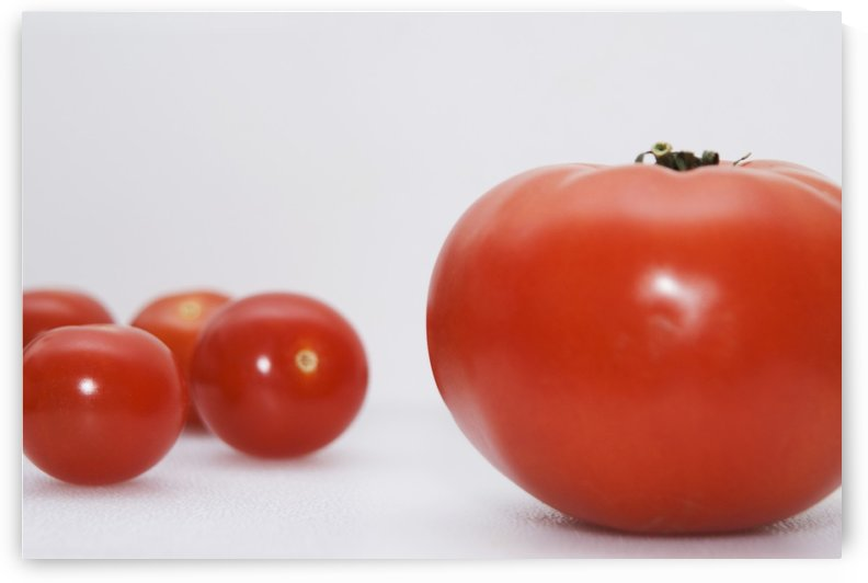 Little Tomatoes And One Big Tomato by PacificStock
