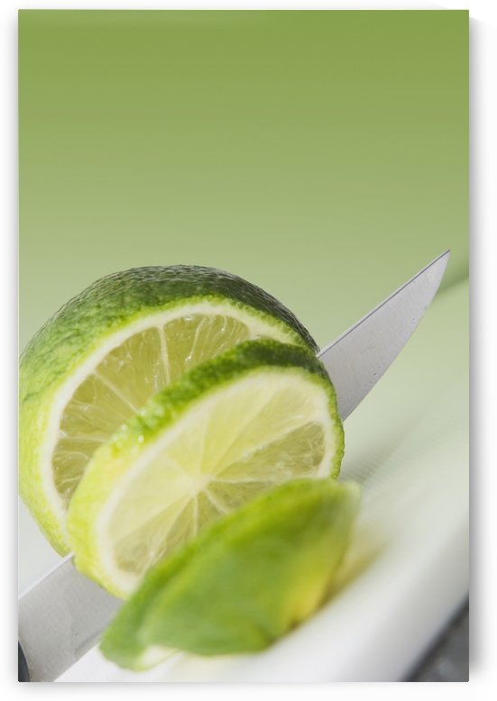 A Knife Cutting A Lime by PacificStock