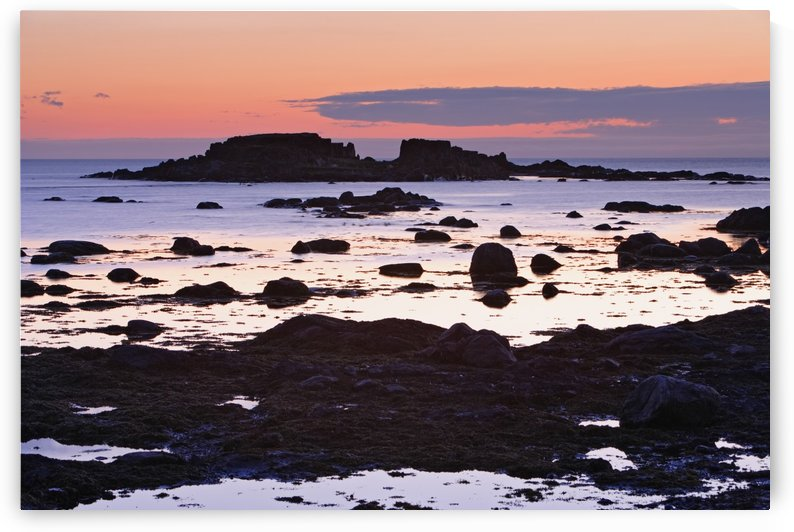 View Of Rock And Sea At Twilight, L'anse Aux Meadows, Newfoundland, Canada by PacificStock
