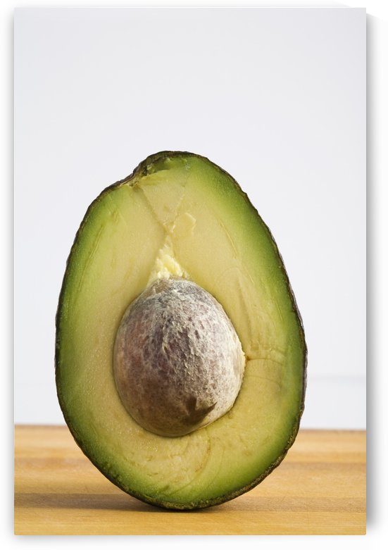 Close Up Of An Avocado Standing Upright Cut In Half With The Pit; Calgary, Alberta, Canada by PacificStock