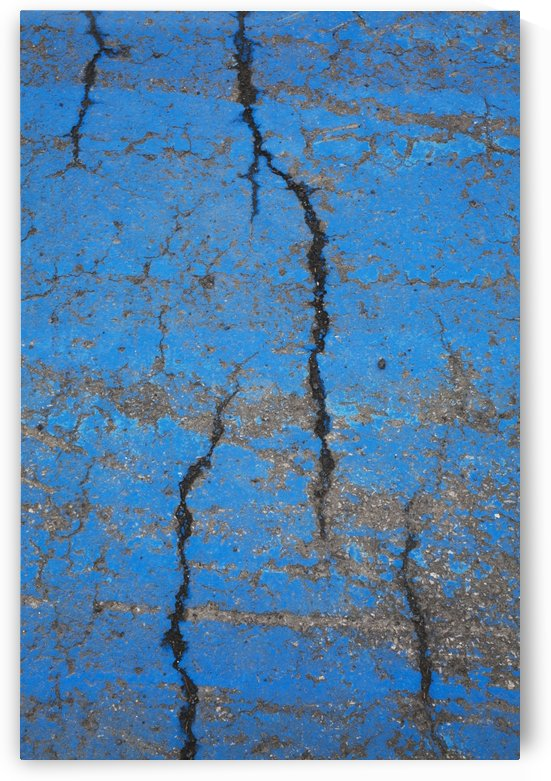Close Up Of Cracks On A Blue Painted Asphalt Surface; Montreal, Quebec, Canada by PacificStock
