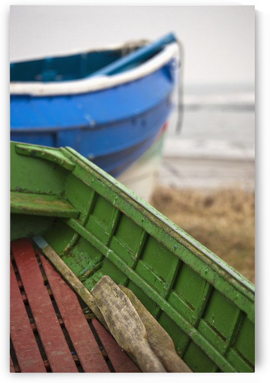 Paddles in a colourful wooden rowboat on the shore;Boulmer northumberland england by PacificStock