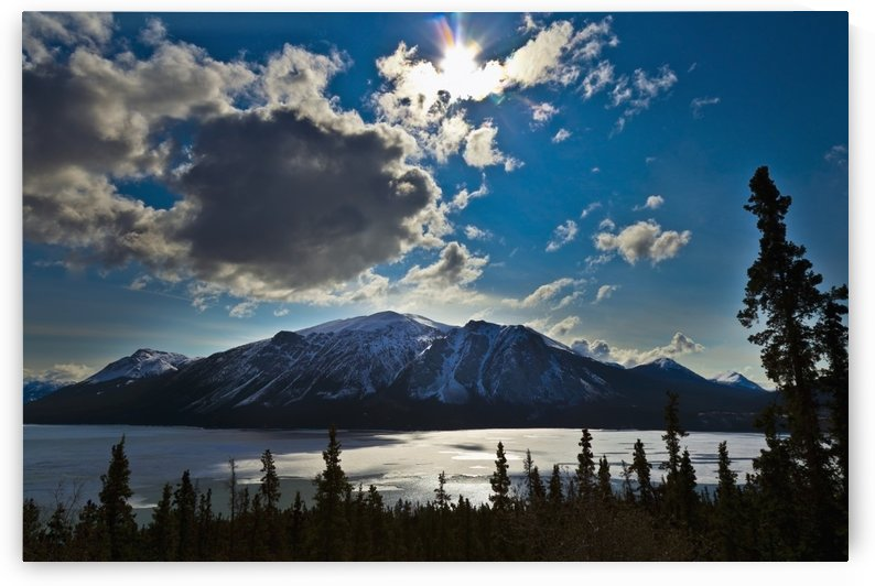 Frozen tagish lake and mountains;Carcross yukon canada by PacificStock