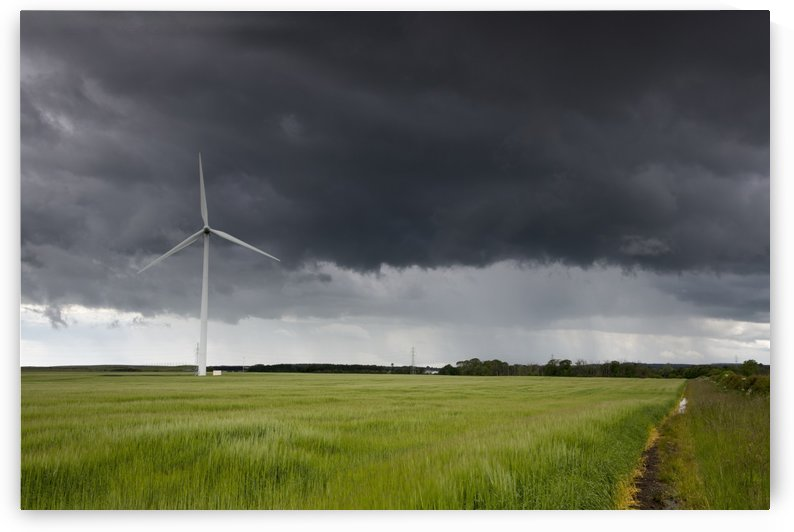 Wind turbine and storm clouds;Northumberland england by PacificStock