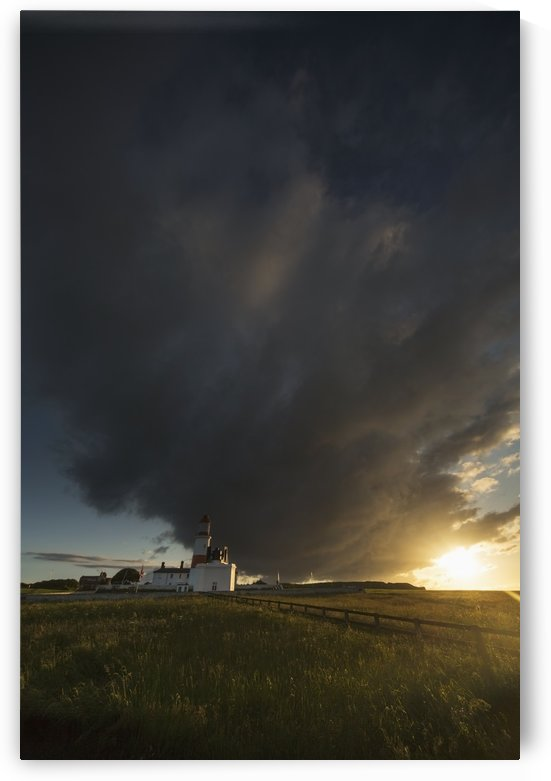 Storm cloud formation over a lighthouse at sunset;South shields tyne and wear england by PacificStock