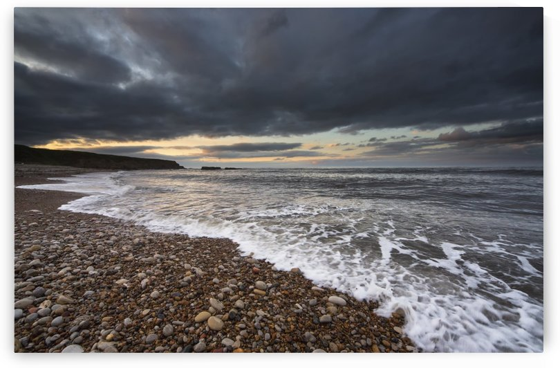 Water coming up on the shore under storm clouds;Sunderland tyne and wear england by PacificStock