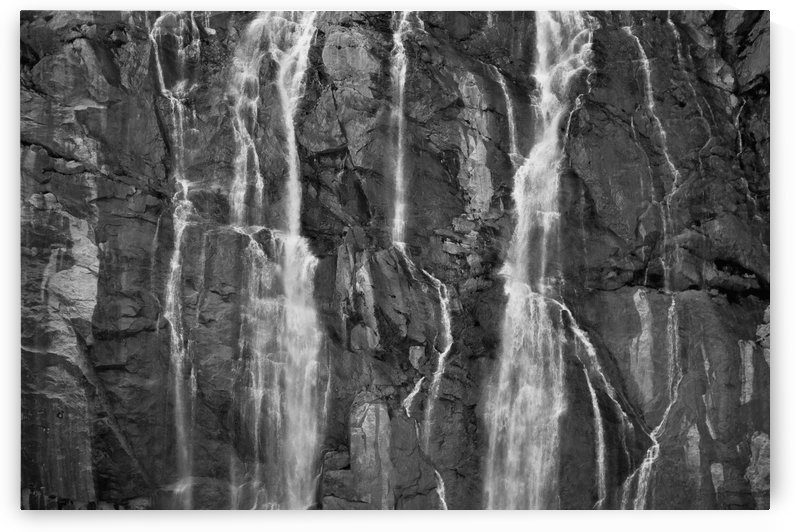 A Waterfall Cascades Over Rock Cliffs On The Juneau Ice Field In Southeast Alaska by PacificStock