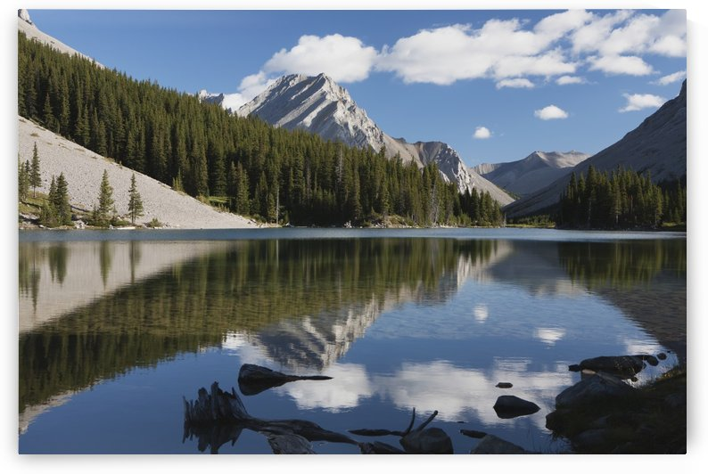 Mountain reflecting in lake with blue sky and clouds in kananaskis provincial park;Alberta canada by PacificStock