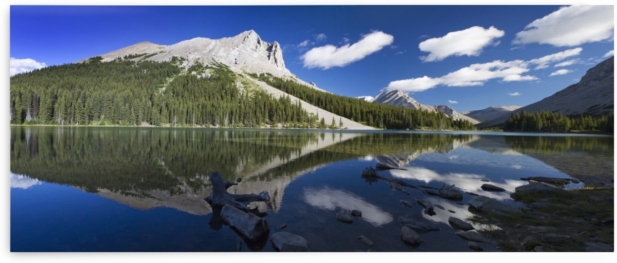 Panorama of a mountains reflecting on a mountain lake with blue sky and clouds in kananaskis provincial park;Alberta canada by PacificStock