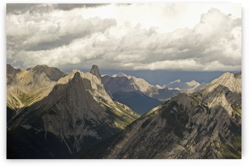 Cloud over rugged mountain peaks;Banff alberta canada by PacificStock