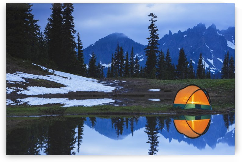 Camping tent at sunset by a small reflecting pond near tipsoo lake mount rainer national park near seattle;Washington united states of america by PacificStock