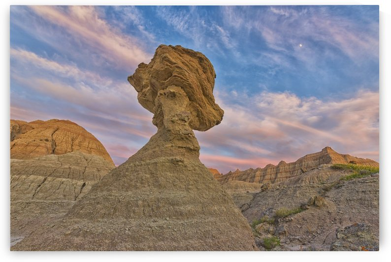 A large hoodoo balanced on a pedestal badlands national park; south dakota united states of america by PacificStock