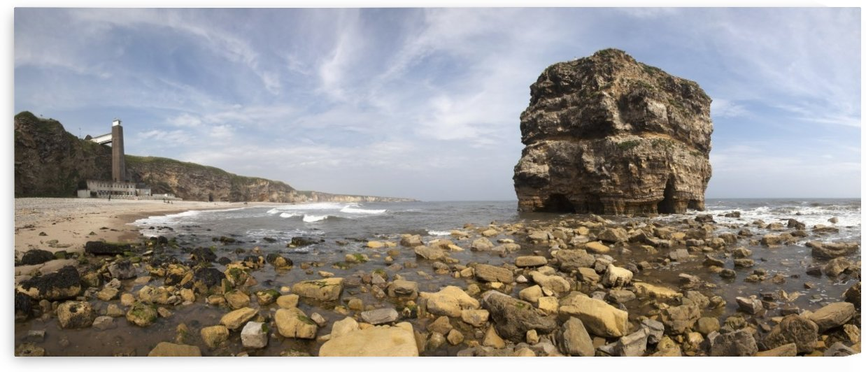 Large rock formation along the coastline at low tide;South shields tyne and wear england by PacificStock