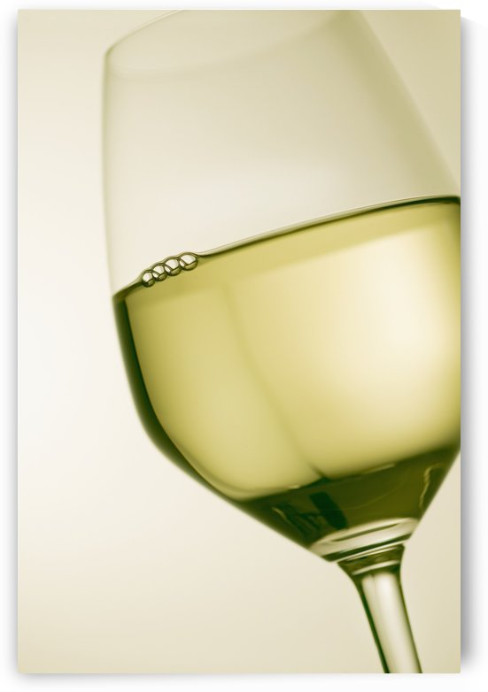 A glass of white wine by PacificStock