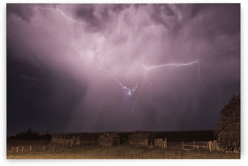 Lightning bolt over some abandoned buildings near val marie;Saskatchewan canada by PacificStock