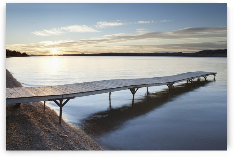A dock in lake superior at sunset;Thunder bay, ontario, canada by PacificStock