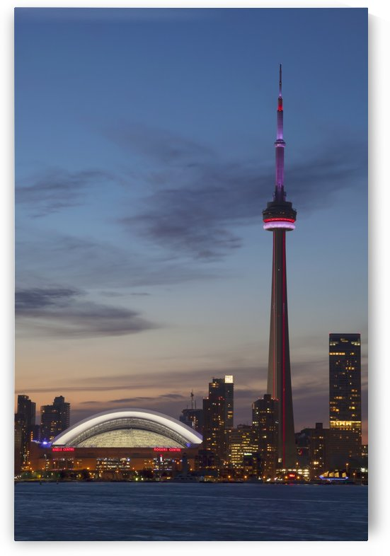View over lake ontario of the downtown toronto skyline and cn tower illuminated at dusk;Toronto ontario canada by PacificStock
