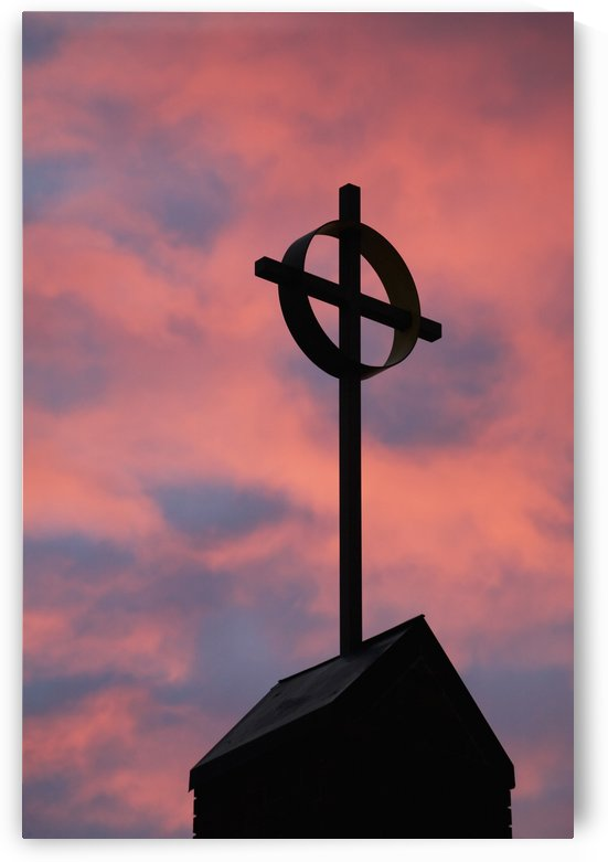 Silhouette of a cross on church steeple with fiery cloud cover in the sky at sunrise;Calgary alberta canada by PacificStock