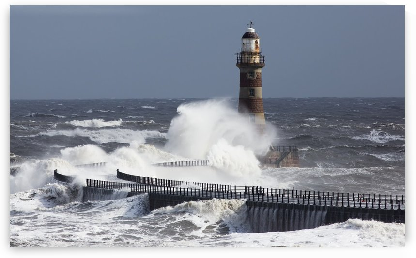 Waves crashing into a lighthouse on the coast;Sunderland Tyne and Wear England by PacificStock
