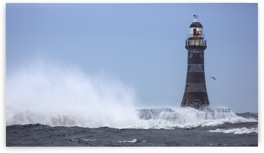 Splashing water from a crashing wave against a lighthouse;Sunderland Tyne and Wear England by PacificStock