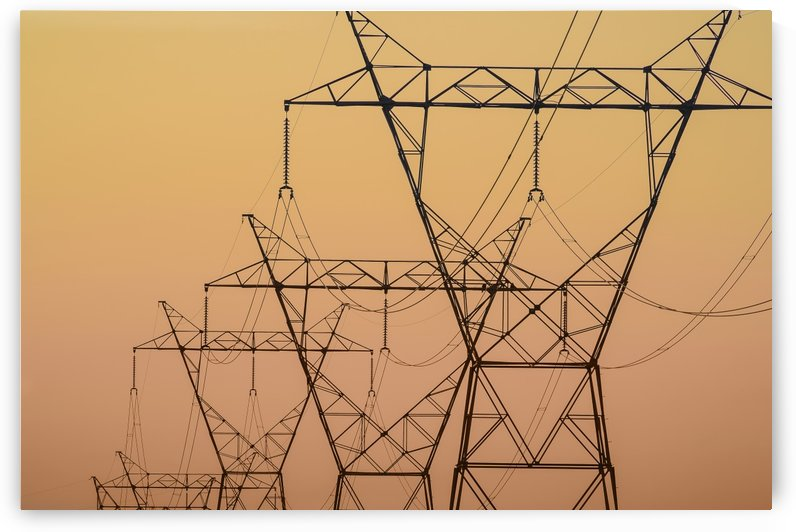 Electrical transmission towers at sunset;Ohio united states of america by PacificStock