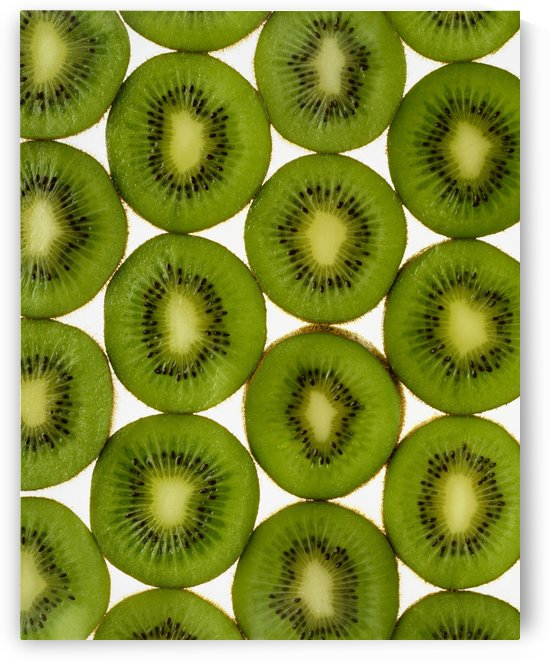 Agriculture - Kiwi slices arranged in rows and backlit, studio. Version 2. by PacificStock
