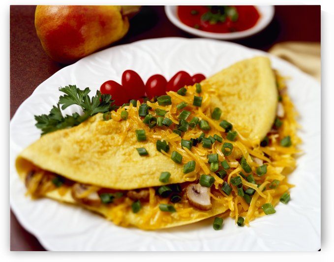 Food - Cheese and Mushroom Omelette garnished with chopped green onions (scallions) and pear tomatoes. by PacificStock