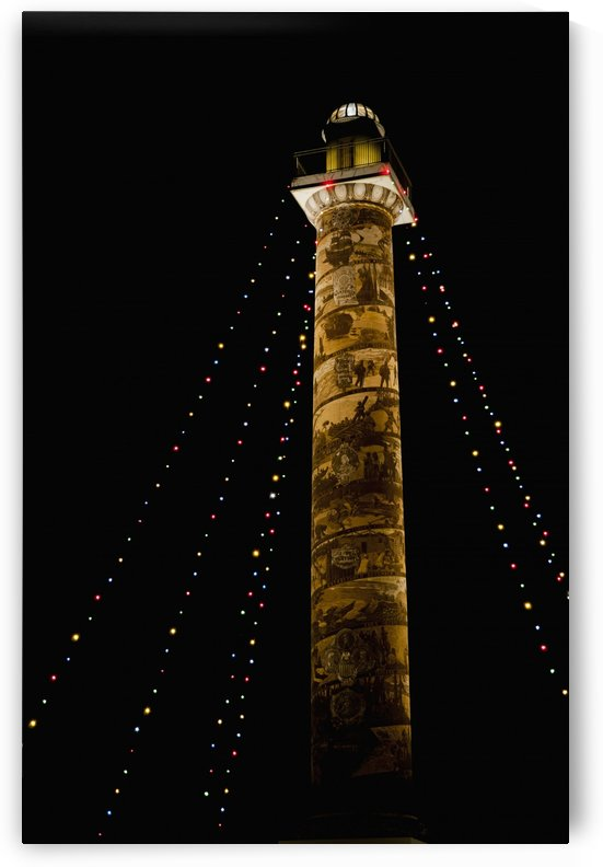 Holiday lights brighten the Astoria Column; Astoria, Oregon, United States of America by PacificStock