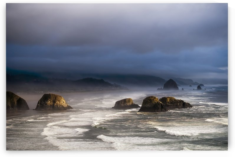 Sunlight and mist create coastal moods; Cannon Beach, Oregon, United States of America by PacificStock